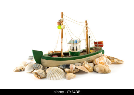 old danish model fish boat and beach shell isolated on white - Stock Photo