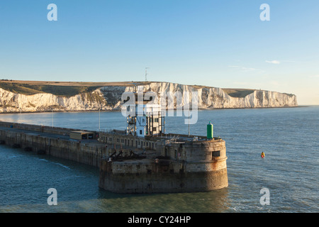Port of Dover breakwater and white cliffs at dawn, Kent, England - Stock Photo