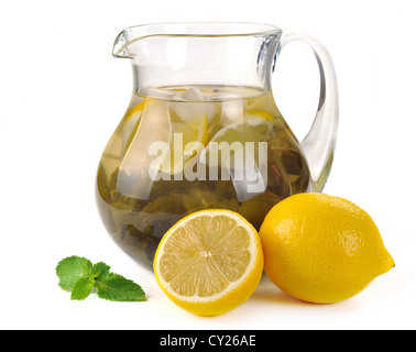 lemon-mint drink in a pitcher with lemons - Stock Photo