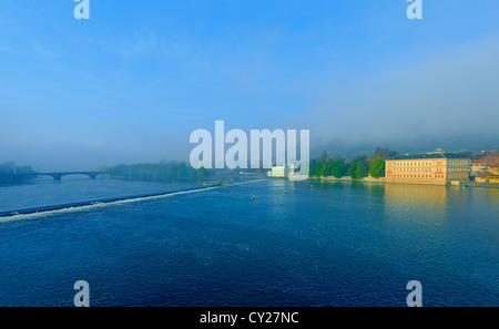 Misty sunrise over the Vltava River. Early in the morning. Spring. - Stock Photo