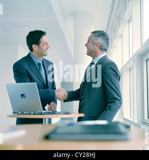 business people man  confidence cooperation laptop notebook smile manager License free except ads and outdoor billboards - Stock Photo