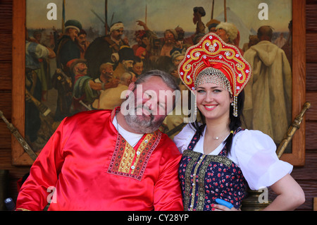 Ukrainian people wearing Ukrainian traditional clothing which contains elements of Ukrainian ethnic embroidery. - Stock Photo