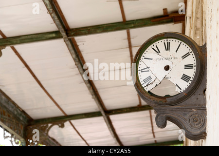 Broken clock in an abandoned train station - Stock Photo
