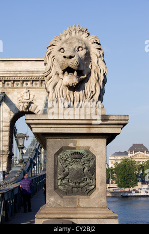 19th century guardian Lion sculpture on the Szechenyi Chain Bridge in Budapest, Hungary. - Stock Photo