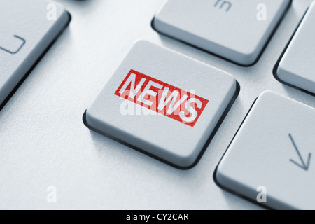 Hot news key button on keyboard. - Stock Photo