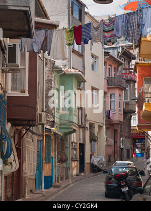 Clothes line, washing and  old houses in traditional Turkish style in a street in  the Balat district of Istanbul - Stock Photo