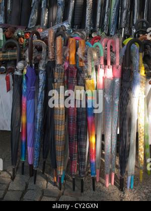 Closed umbrellas on display in shop in Kadiköy Istanbul Turkey - Stock Photo