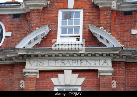 Oliver Whitby's motto above the door of what was the school he founded. Now Army and Navy Stores, Chichester - Stock Photo