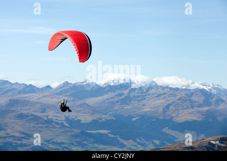 A paraglider paragliding, the Swiss Alps, Switzerland europe - Stock Photo
