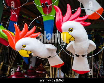 Kitsch lawn art for sale in the form of two cockatoos at a street market in Asunción Paraguay. - Stock Photo