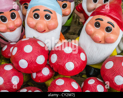 A group of trolls and mushrooms for sale as kitsch lawn art at a street market in Asunción Paraguay. - Stock Photo