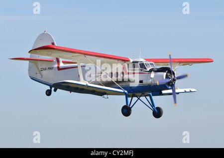 Antonov An-2TP biplane displaying at Duxford Airshow 2012 - Stock Photo