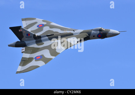 Avro Vulcan bomber aircraft in RAF camouflage displaying at Duxford Airshow. Vulcan B2 XH558 was the last flying - Stock Photo
