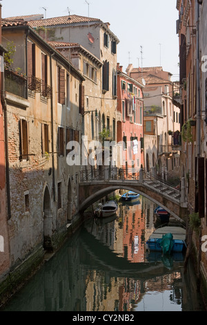 View of residential buildings down a small canal in Venice, Italy - Stock Photo