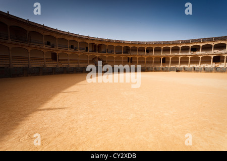 Landscape view of the interior of an empty old classic bull fighting ring stadium seating area in Ronda, Spain - Stock Photo