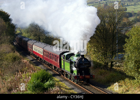 61306 British Railways 'Mayflower' 1940s LNER Thompson-class B1 restored engine, running at speed at heritage steam - Stock Photo