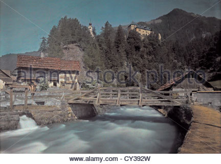 A scenic view of a bridge spanning this stream in the Moll Valley. - Stock Photo