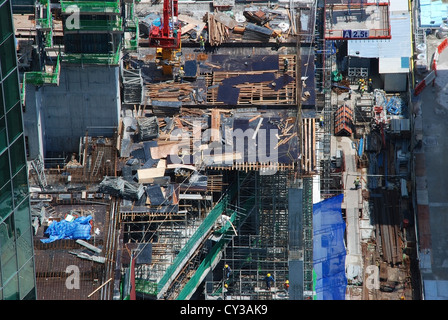 Construction site in the financial district of  modern city-state Singapore, Southeast Asia. - Stock Photo