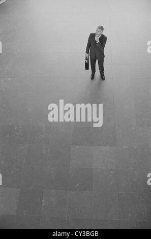 black and white business man business man standing gone with suitcase License free except ads and outdoor billboards - Stock Photo