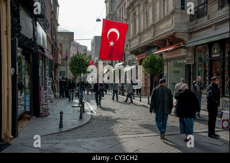 A large Turkish flag hangs over the street I in Istanbul Turkey - Stock Photo