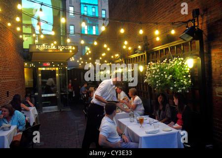 Boston Massachusetts Cambridge Harvard Square Russell House Tavern  Restaurant Alfresco Dining Waiter Tables Night   Stock