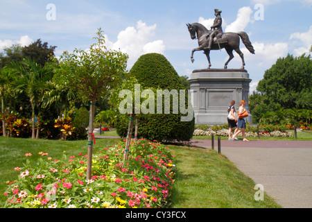 Boston Massachusetts Boston Public Garden George Washington bronze statue flowers - Stock Photo