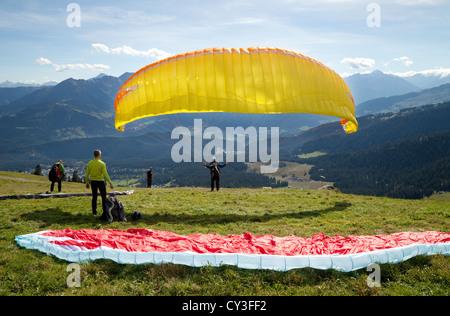 Paraglider taking off in the Swiss Alps at Flims, Graubunden, Switzerland, Europe - Stock Photo