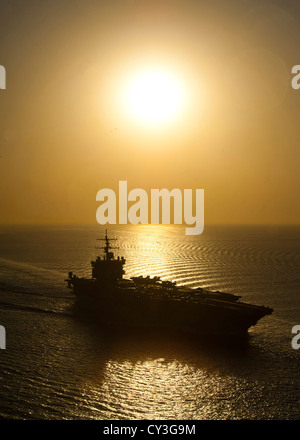 The aircraft carrier USS Enterprise at sunset October 2, 2012. Enterprise was deployed to the US 5th Fleet area - Stock Photo