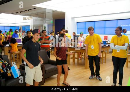 Boston Massachusetts Boylston Street Shops at Prudential Center shopping Microsoft Store Asian Black employee teen - Stock Photo