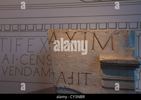 Roman letters and numerals Carved in stone. - Stock Photo