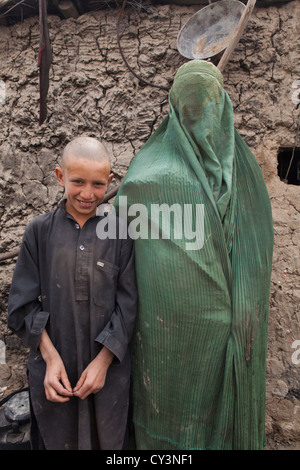 Mohammed Kasim and his mother in boerka - Stock Photo