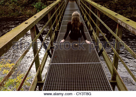 Woman on bridge - Stock Photo