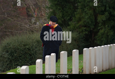 Michael Morpurgo, author of War Horse visits the WW1 Ramparts Cemetery at Lille Gate in Ieper (Ypres ) in Belgium. - Stock Photo