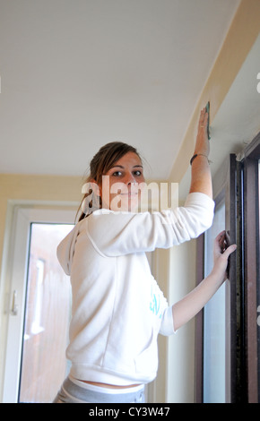 friends doing embroidery together young woman home owner 20s doing diy painting and decorating in newly bought flat stock