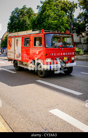 German Feierwehr Fire Engine seen on the streets of Ulm - Stock Photo