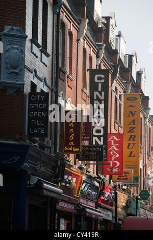 Details of signs for Indian restaurants on Brick Lane, London, UK - Stock Photo