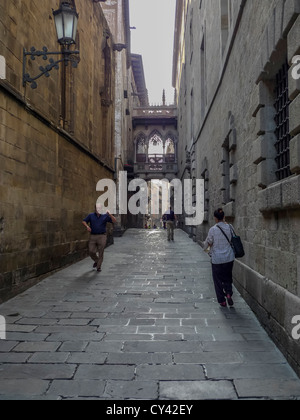A man does a spontaneous jig on the Carrer del Bisbe near the Cathedral (La Seu) in Barcelona, Catalonia, Spain - Stock Photo