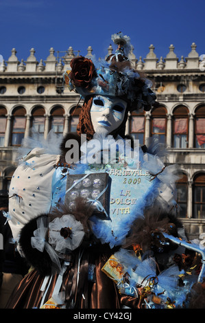 Mask wearers, Carnival in Venice, Italy. - Stock Photo