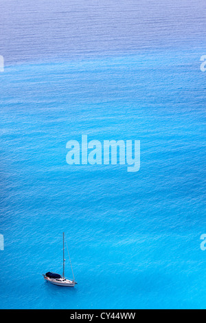 Sailing ship in the amazing cyan colored Ionian sea. - Stock Photo