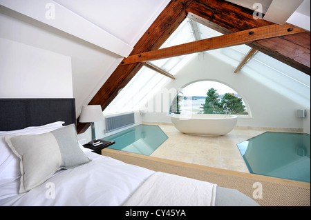 The master bedroom of a modern luxury holiday home near Abersoch on the Lleyn Peninsula in North Wales UK