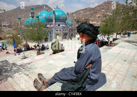 Afghan boy in front of a shia mosque in kabul - Stock Photo
