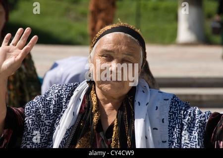 Uzbek woman having fun and dancing, Samarkand, Uzbekistan - Stock Photo