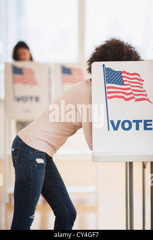 USA, New Jersey, Jersey City, Woman in voting booth - Stock Photo