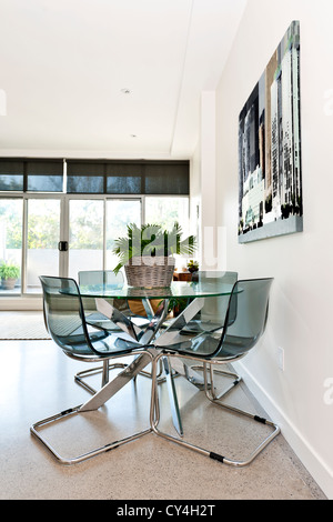 Dining table and chairs in loft apartment - artwork from photographer portfolio - Stock Photo
