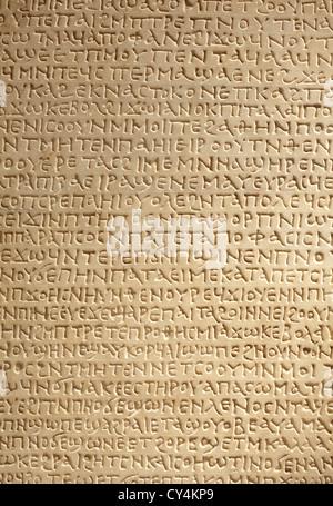 Ancient greek writing on stone background - Stock Photo