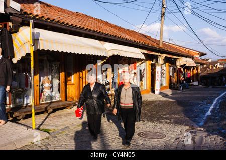 Old women walking through the old Bazaar in Gjakova, Kosovo. - Stock Photo