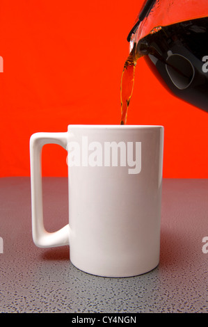 Blank White coffee mug being filled with coffee, add your own text or graphic - Stock Photo