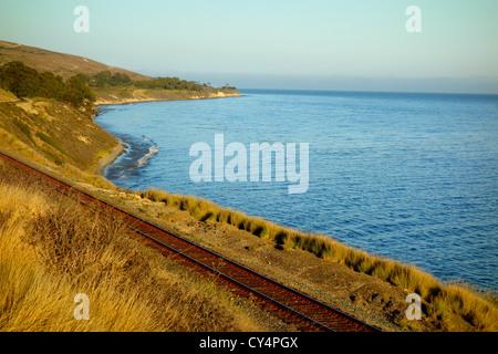Amtrak train tracks along the ocean at Hollister Ranch on the Gaviota coast in California, USA. - Stock Photo