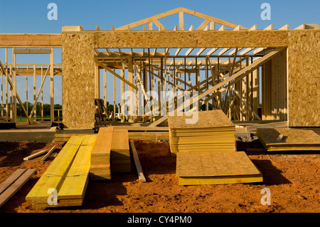 House, home under construction against blue sky - Stock Photo