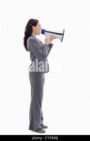 Businesswoman speaking loudly into a megaphone - Stock Photo